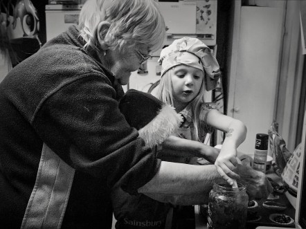 Children making mince pies with grandmother