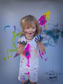 Birthday photography Kent Paint splash boy looking at hands