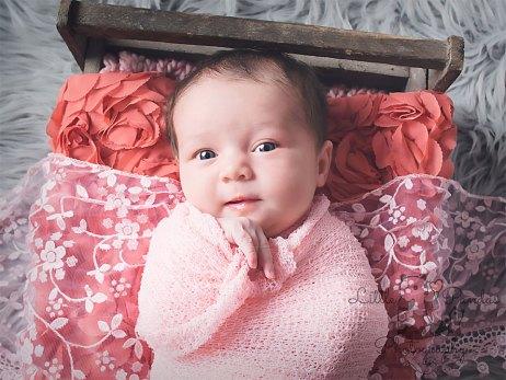 Baby girl awake in pink