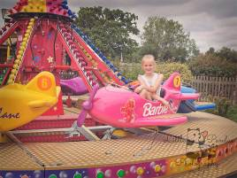 Girl on fairground ride