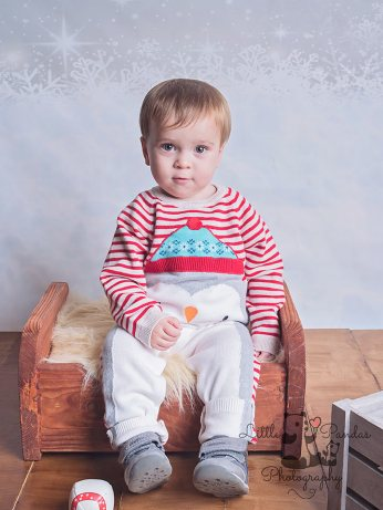 close up little boy in christmas outfit