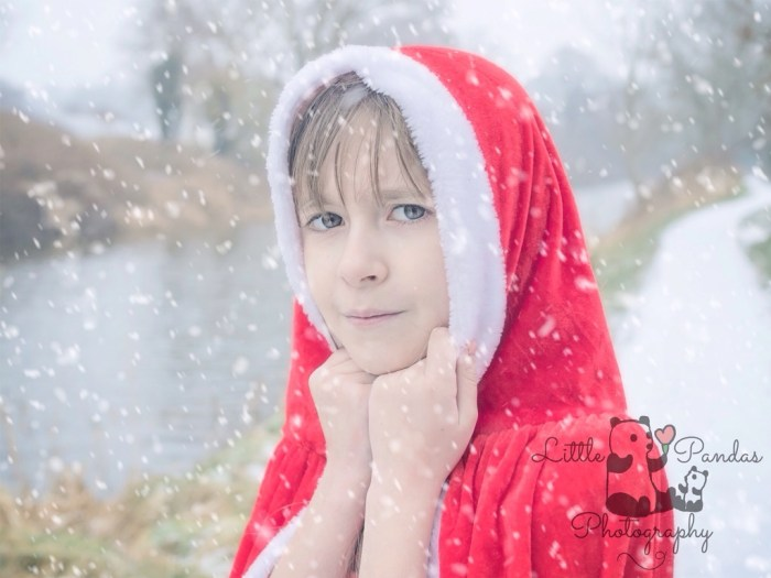 Little girl in red cape close up