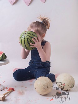 Boy drinking juice out of melon