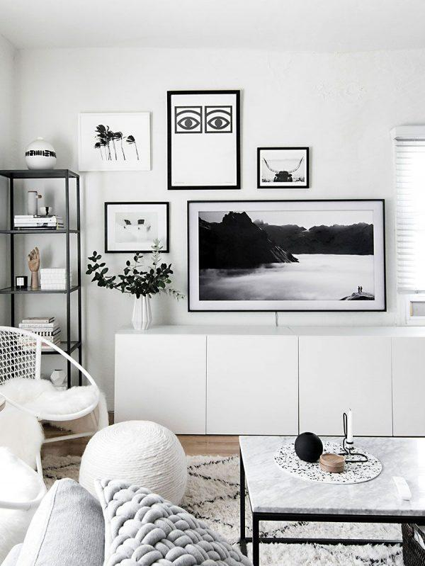 hanging pictures over tv