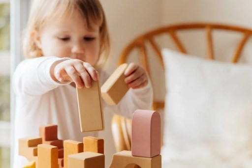 Building with small wooden blocks