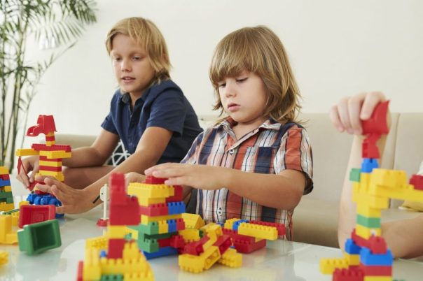 boys playing blocks during online church