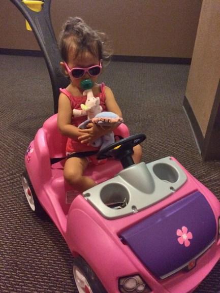 Ride pink car? Sunglasses?