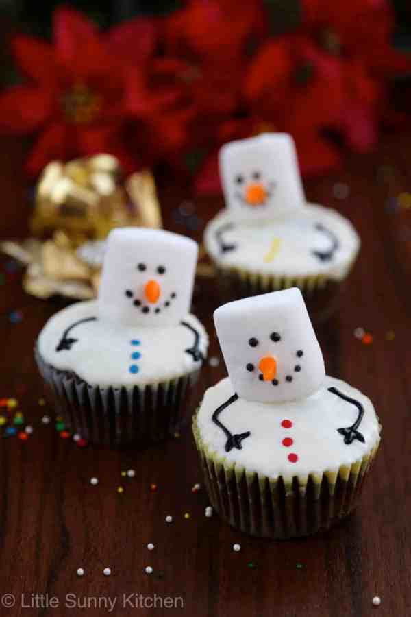 Snowman Cupcakes with vanilla frosting, sprinkles or funfetti and white marshmallows