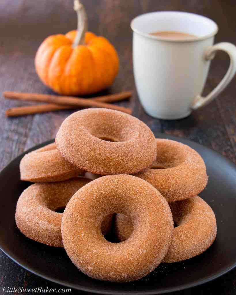 These baked pumpkin donuts are super soft and moist with a delightful pumpkin taste and crunchy cinnamon-sugar coating. (pumpkin donuts, pumpkin spice donuts, baked pumpkin donuts, homemade pumpkin donuts, Tim Hortons, pumpkin cake donuts)