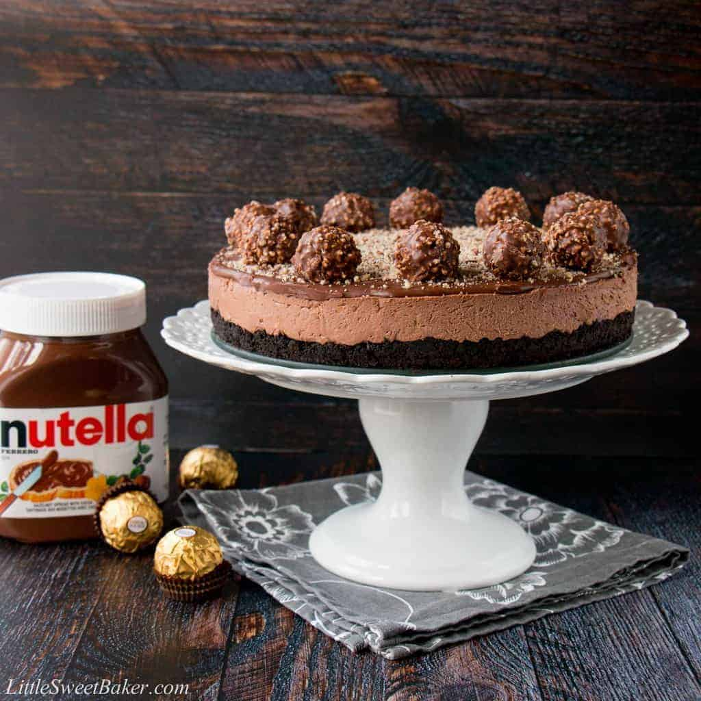 Oreo cookie crust with a Nutella cheesecake filling, topped with more Nutella and decorated with Ferrero Rocher candies. This no-bake recipe is the easiest and most delicious Nutella cheesecake you will ever make!