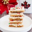 Light and crispy saltine crackers surrounded by a buttery toffee and topped with creamy white chocolate makes this little treat absolutely addictive! You won't be able to just one. #whitechocolate #christmascrack #crackcandy #christmastoffee #saltinetoffee #saltinecrackertoffee
