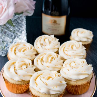 These cupcakes are rich, moist and full of champagne flavor. They are topped with a sweet and tangy champagne buttercream, and some gold sprinkles to make them extra special! #champagnecupcakes #champagnefrosting #mothersday #newyearseve #recipe #dessert