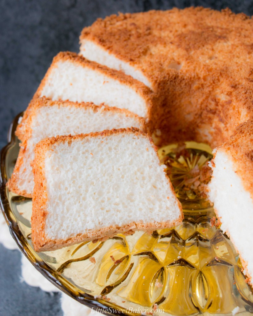 This moist, soft and fluffy angel food cake is a perfect summer dessert. It's light as air and is essentially fat-free! #angelfoodcake #easyangelfoodcake #angelfoodcakerecipe