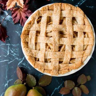 This incredible pear pie is sweetened with maple syrup and lightly spiced with ginger. The filling is made with fresh pears which gives it a lovely tender-crisp texture. #pearpie #gingerpearpie #maplepearpie #easypearpie