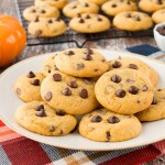 These soft and chewy pumpkin chocolate chip cookies are a perfect taste of fall. They have a lovely pumpkin flavor, lightly spiced and just the right amount of chocolate in every bite! #pumpkinchocolatechipcookies #chewypumpkinchocolatecookies #bestpumpkinchocolatechipcookies
