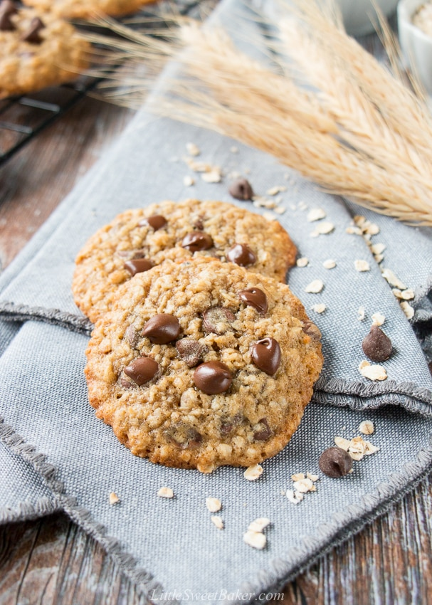 These cookies are crispy on the edges, soft in the middle, and loaded with chocolate chips. They are a perfect mix of decadent chocolate chip cookies and wholesome oatmeal cookies. #oatmealchocolatechipcookies #recipe