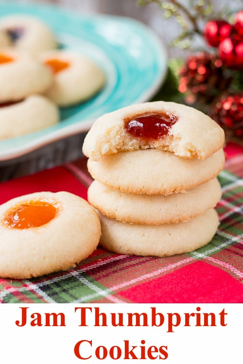 This classic holiday cookie is buttery and chewy with a delicious pocket of jam. #thumbprintcookies #Christmascookies #recipe #sugarcookie