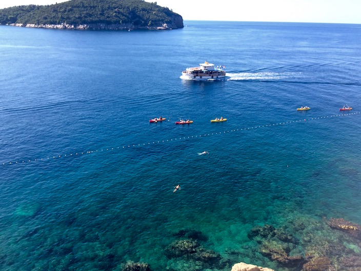 Kayaks boats islands and swimming in Croatia