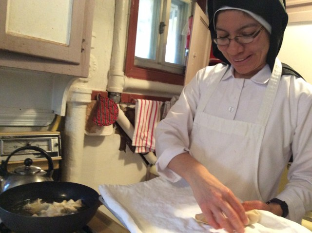 Sr Rosana cooking in kitchen