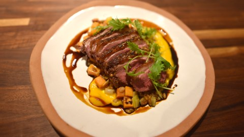 Chef Kevin Adey at Faro in Brooklyn, NY dresses his dry aged duck breast with his variation of fish sauce caramel. (Photo courtesy of Faro.)
