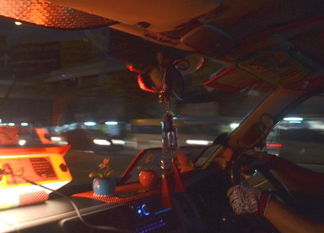 Minivan Driver in Bangkok Traffic at Night, Southeast Asia