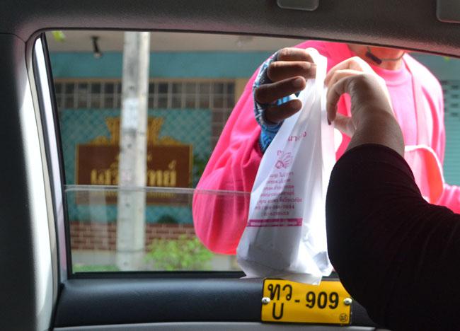 Fried Bananas Transaction Kuay Tod in Bangkok Traffic, Southeast Asia