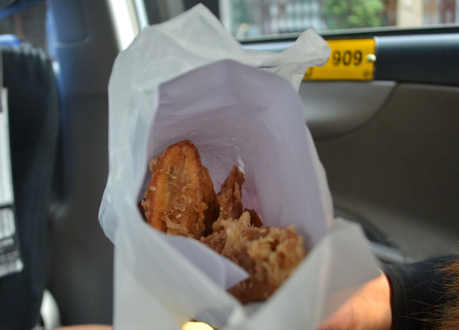 Bag of Deep Fried Bananas Kuay Tod in Bangkok Traffic, Southeast Asia