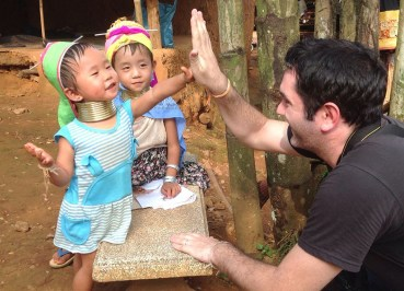 Hi 5 with Young Girl, Chiang Rai Akha Hill Tribes Northern Thailand, Asia