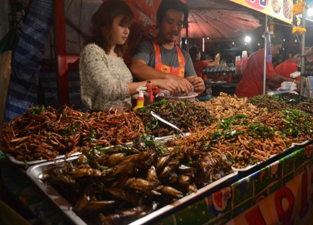 Deep Fried Insects at Chinese New Year celebrations at Pak Nam Pho Chinese Festival in Nakhon Sawan, Thailand. Two day dragon parades. Life in Southeast Asia