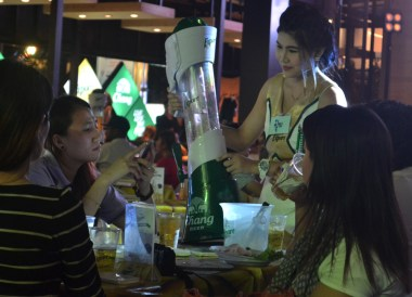 Girls Drinking Beer, Central World Christmas Tree. Beer Gardens. Bangkok