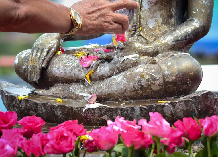 Pouring Water on Buddha Statue Ceremony for Songkran Festival in Thailand