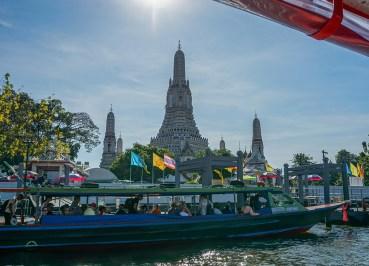 Boat Passing Wat Arun on the Bangkok Riverside Attractions
