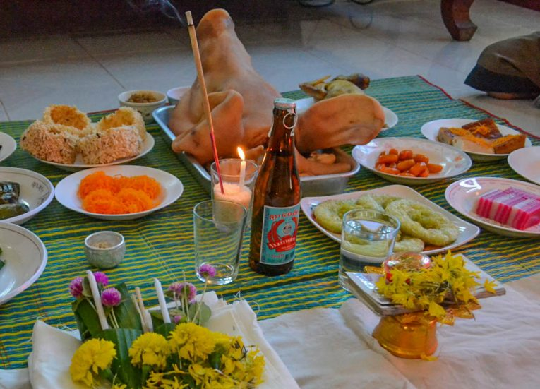Bottle of Lao Khao Rice Whisky with Traditional Feast in Thailand