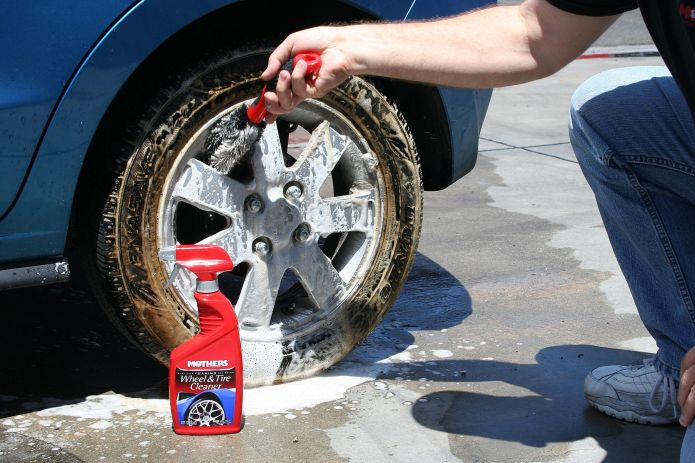 scrubbing car wheels and tires