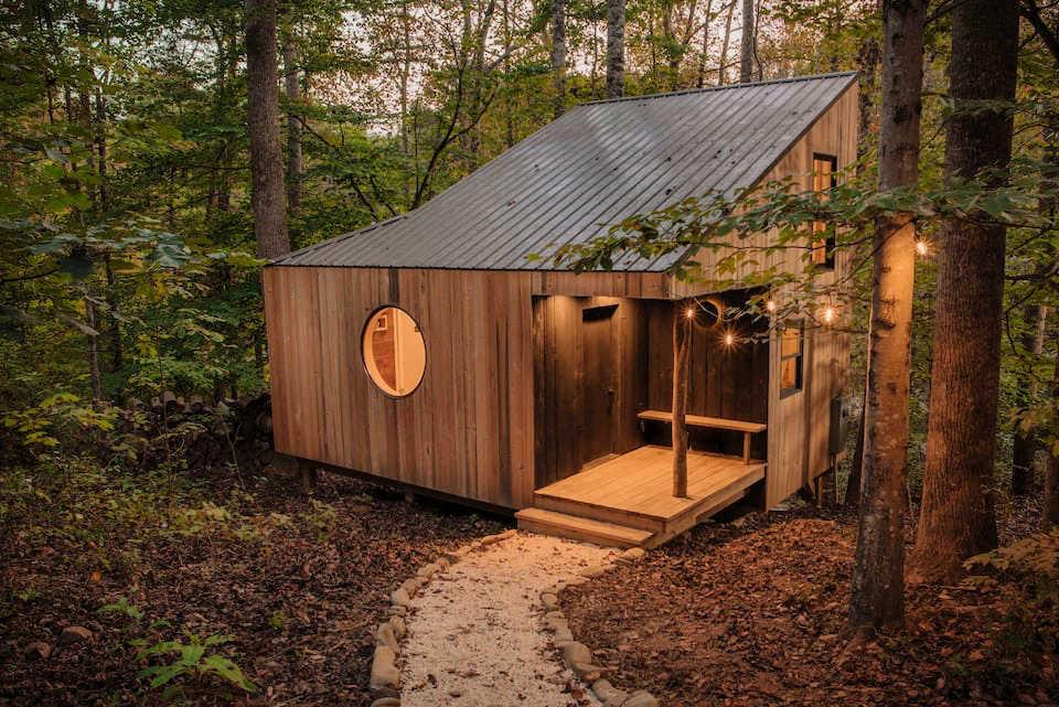 sleek wood cabin in forest