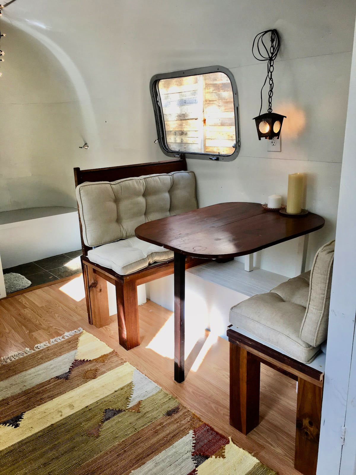 bench and table seating inside airstream