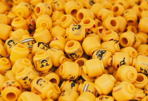 Close up of lots of yellow lego heads