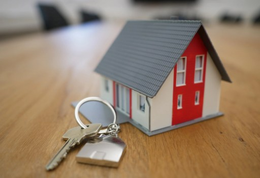 Mini house on a keyring with a key