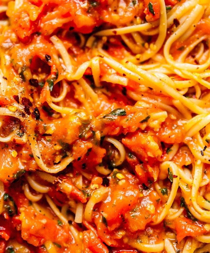 Homemade marinara sauce mixed with spaghetti