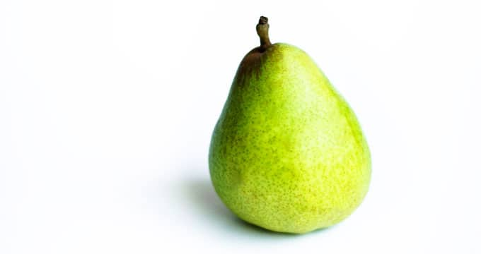 Comice pear on a white background