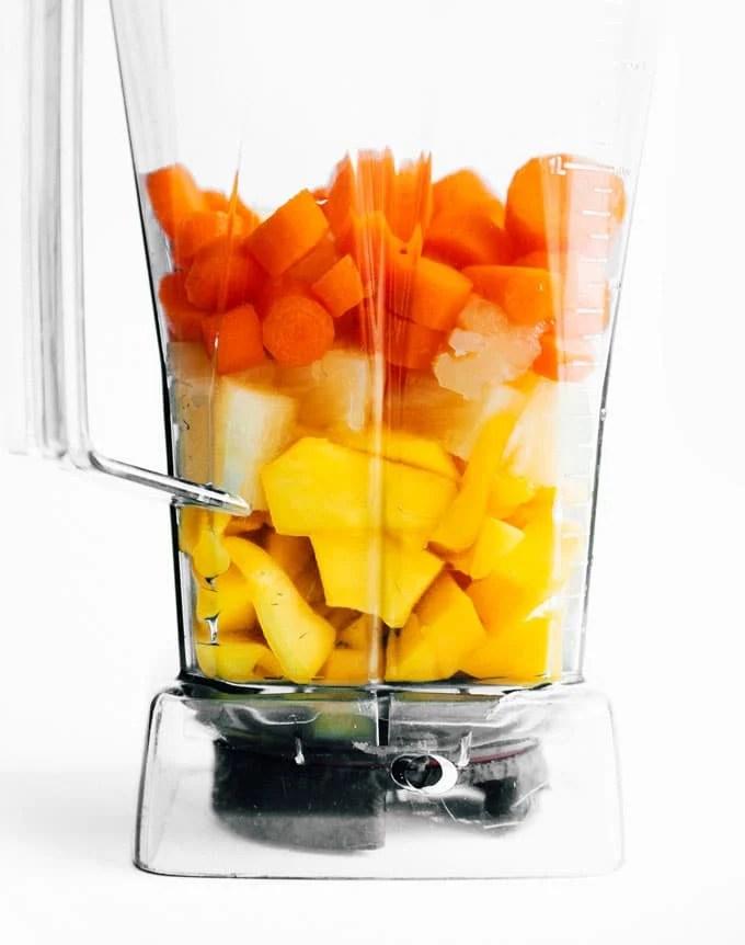 Ingredients to make carrot juice in a blender