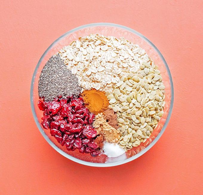 Stirring together pumpkin granola ingredients in a bowl