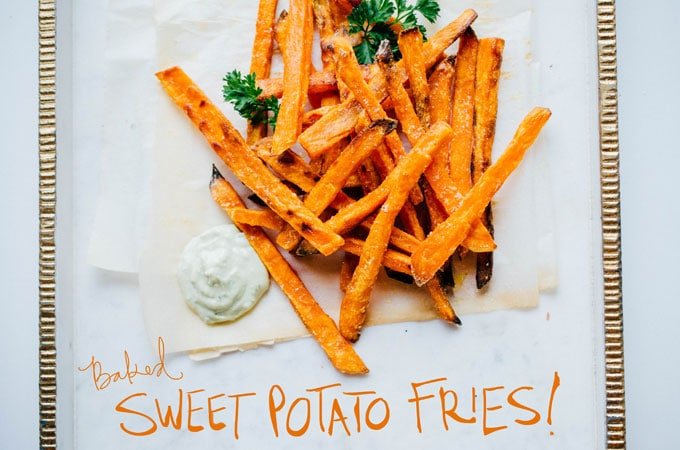 These Baked Sweet Potato Fries are crispy on the outside, tender on the outside, and dipped in a creamy, herby avocado sauce.