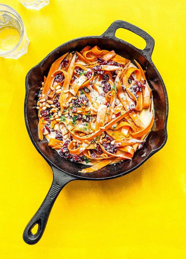 Making sweet potato noodles in a cast iron skillet