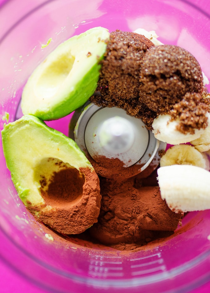 Ingredients for chocolate avocado smoothie in a blender