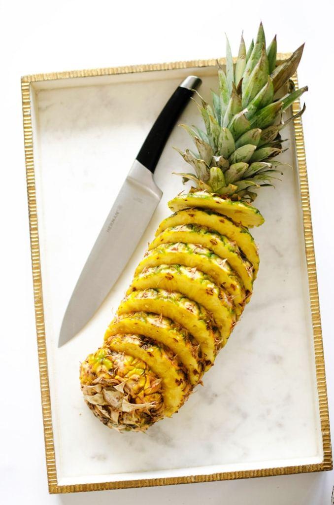 Sliced pineapple on marble