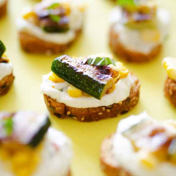 Whipped Feta, Corn, and Zucchini Crostinis