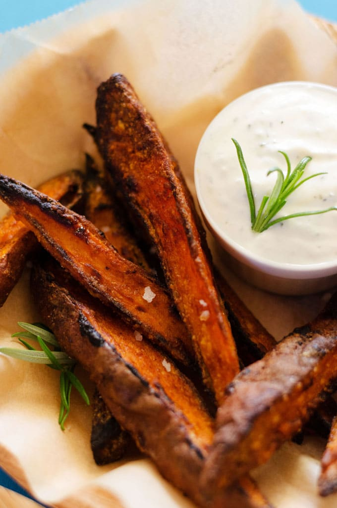 This Oven-Baked Sweet Potato Wedges recipe makes crispy on the outside, tender on the inside, dipped in an herby garlic yogurt sauce fries that you're going to love! Packed with nutrients and low in fat, these are the perfect flavorful side dish or snack for the fall.