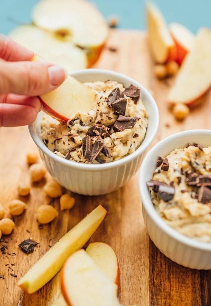 Dipping apples in healthy dessert hummus