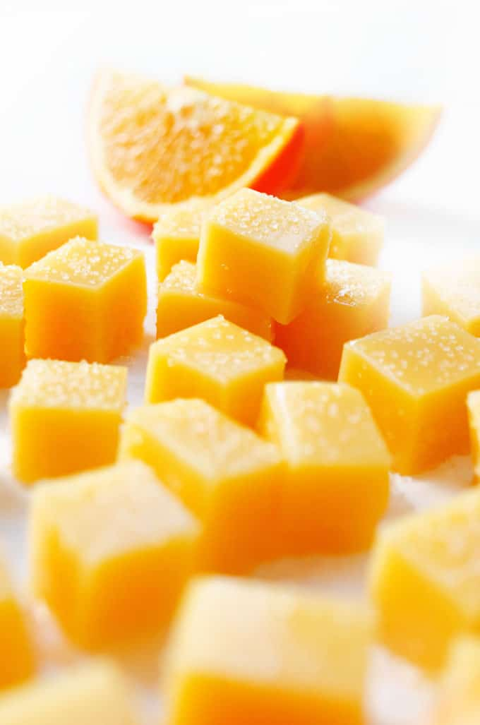 Vegan orange gummies on white background